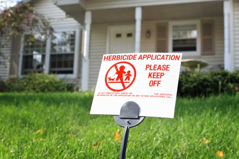 Image of a Pesticide Application Warning Sign in a front yard